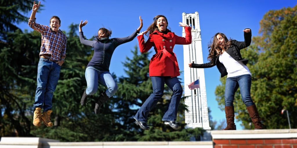 Students jumping in front of the belltower